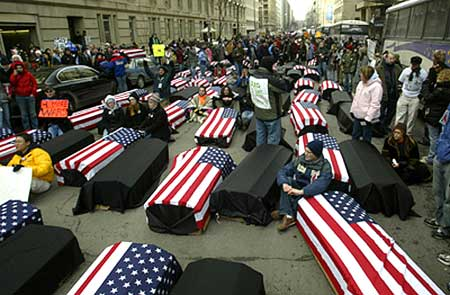 "Symbolic ""coffins"" used to protest George W. Bush's war in Iraq line a street in Washington D.C. Bush was inaugurated for his second term and paraded down Pennsylvania Avenue later."