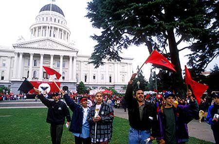 Latinos wave United Farm Worker flags outside the California capitol, where marchers were arriving after a 350-mile foot journey from Delano to Sacramento.